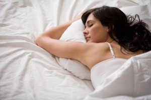 Woman-sleeping-in-bed