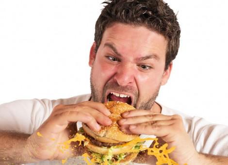 Man eats fatty food