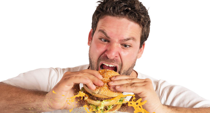 Man eats fatty food